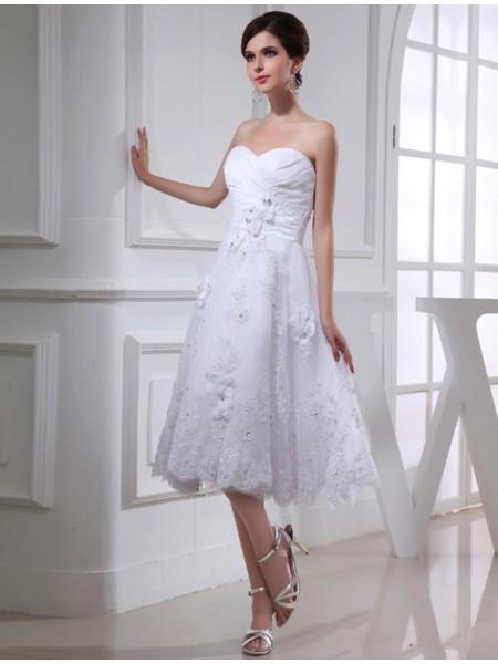 Trapèze/Princesse Perles Col en coeur Sans Manches Organza Appliqués Taffetas Robe de mariée