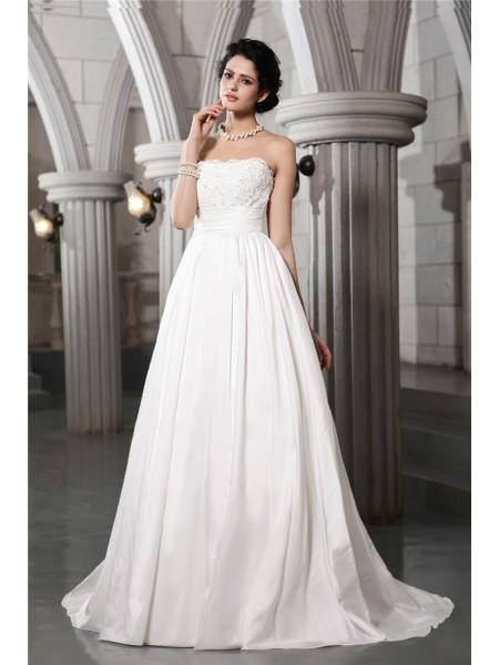 Trapèze/Princesse Sans bretelles Sans Manches Perles Appliqués Longue Taffetas Robe de mariée